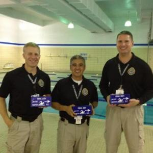 Craig Schwartz-Henry Montes-John Roberts after receiving blue bricks for the 34-mile swim that represents the distance between Quantico and Washington-DC.