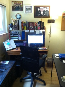 My office. Please note the Three Stooges pix. So much of what I write is serious, they give me comic relief when I need it.