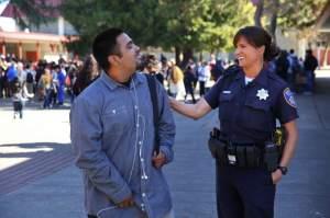 Santa Rosa Police Officer Amanda Cincera jokes with junior Brian Villanueva at Piner High School, in Santa Rosa, on Thursday, October 29, 2015. Officer Cincera is the school resource officer at Piner.(Christopher Chung/ The Press Democrat)