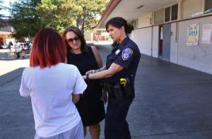 Santa Rosa Police Officer Amanda Cincera, right, works with assistant principal Andrea Correia in following up on a welfare check on Jasmine Phillips at Piner High School, in Santa Rosa, on Thursday, October 29, 2015. Officer Cincera is the school resource officer at Piner.(Christopher Chung/ The Press Democrat)