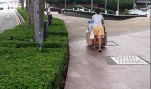 woman pushing car